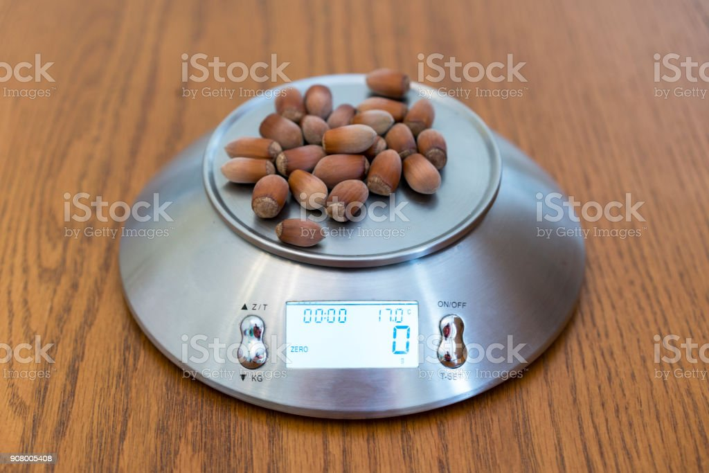 hazelnuts on the scales stock photo