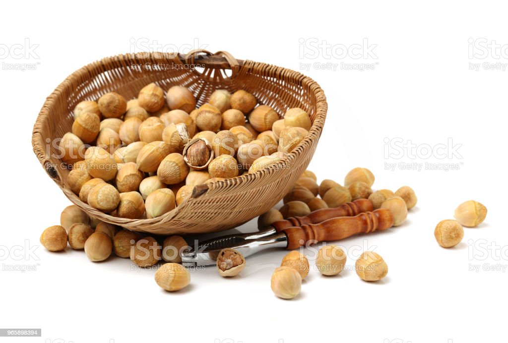 Hazelnuts on white background - Royalty-free Basket Stock Photo