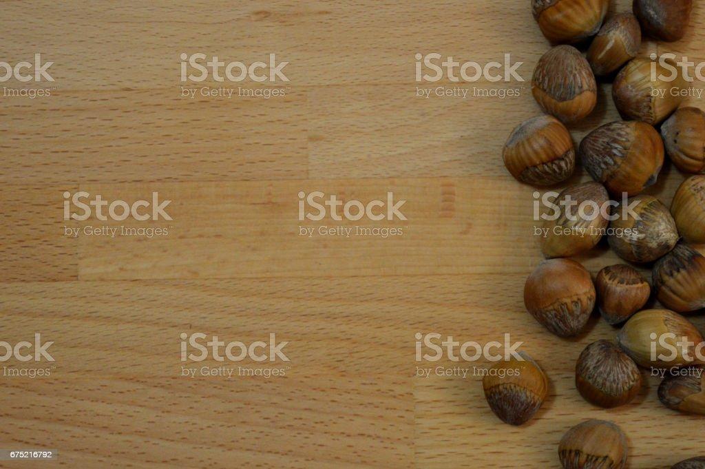 hazelnuts on wooden background royalty-free stock photo