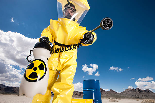 hazmat cleanup - white suit stock photos and pictures