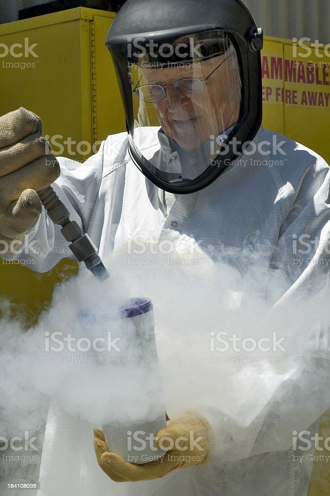 Hazmat Technician Pouring Liquid Nitrogen royalty-free stock photo