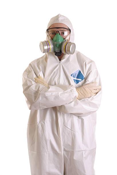 Hazmat worker in protective gear ready to handle hazardous materials stock photo