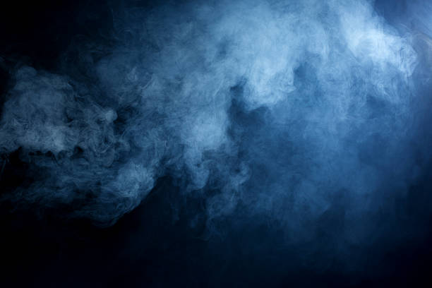 hazy blue smoke on black background - duman stok fotoğraflar ve resimler