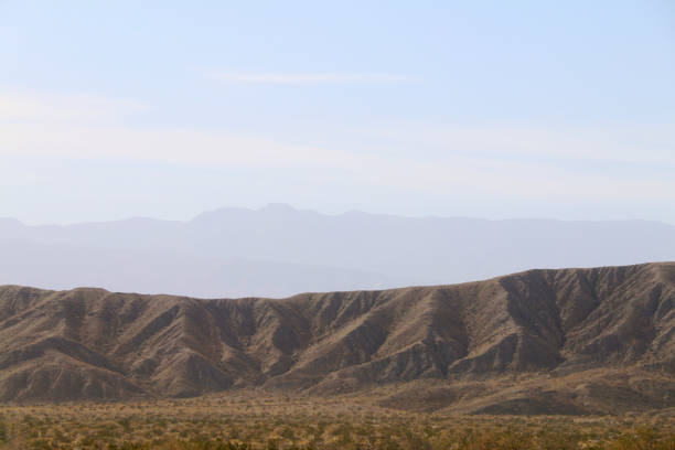 hazy distance desert mountain range stock photo