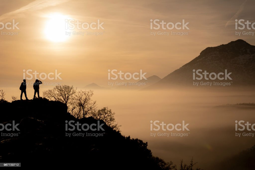 hazy, foggy and mixed mountain scenery and mountaineers adventures stock photo