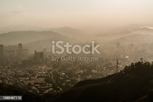 dark moody view of troubled caracas city, symbol of venezuela crisis
