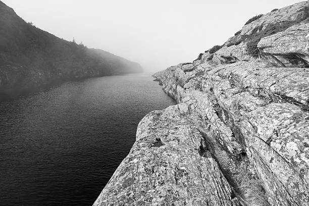 Hazy morning at Norwegian fjord stock photo
