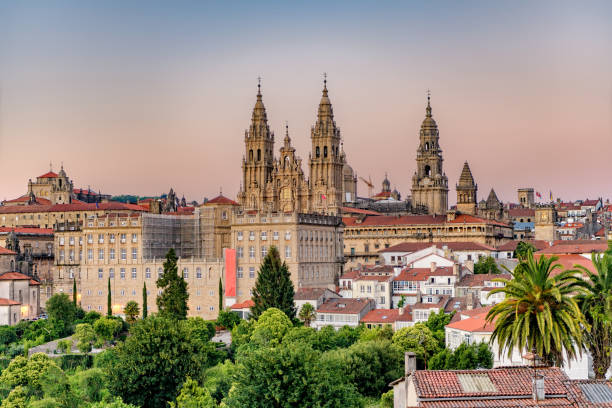 hazy sunset on santiago de compostela cathedral and city view. - spain stock pictures, royalty-free photos & images