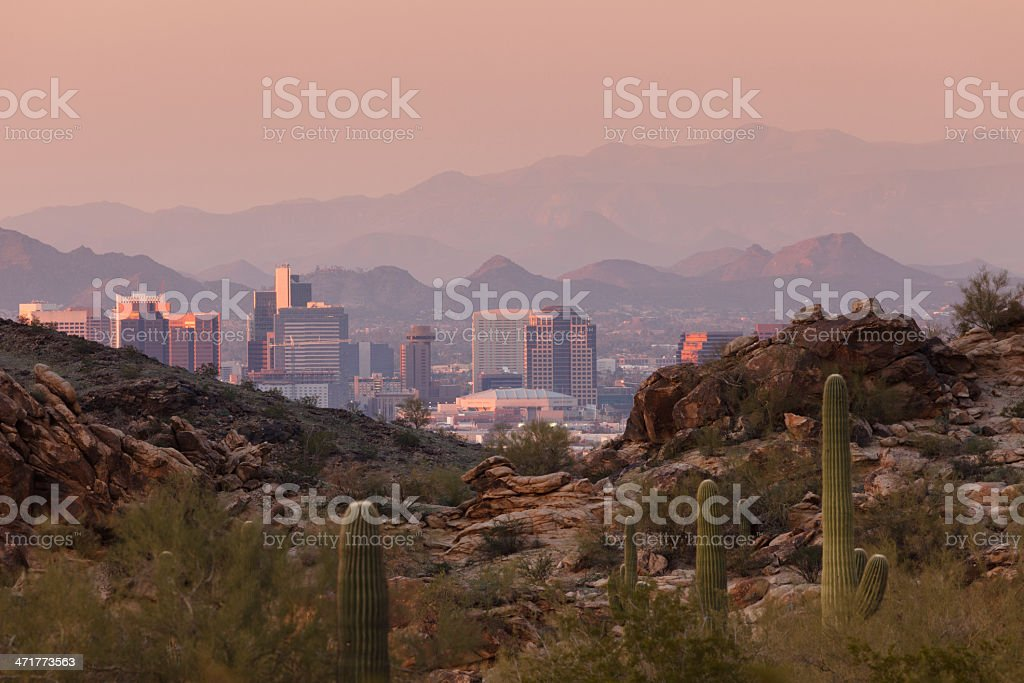 Hazy sunset skyline of Phoenix Arizona city and landscape stock photo