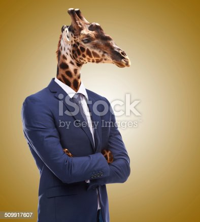 Studio shot of a businessperson with a giraffe head