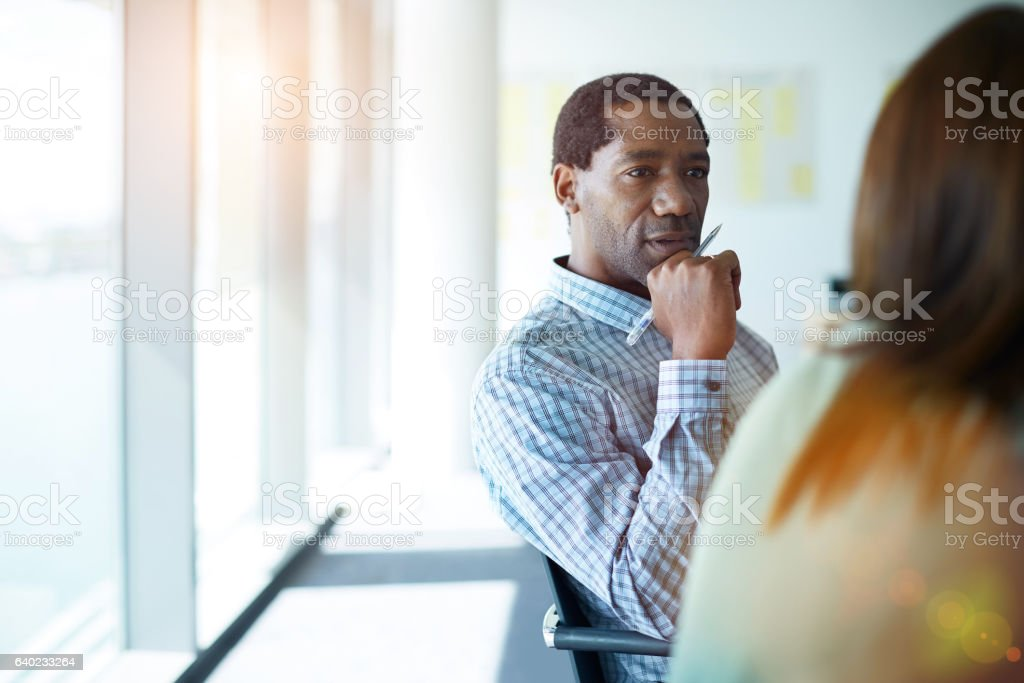 He always gives his undivided attention in meetings stock photo