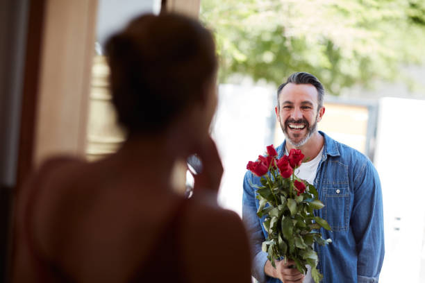He always makes her Valentine's special stock photo