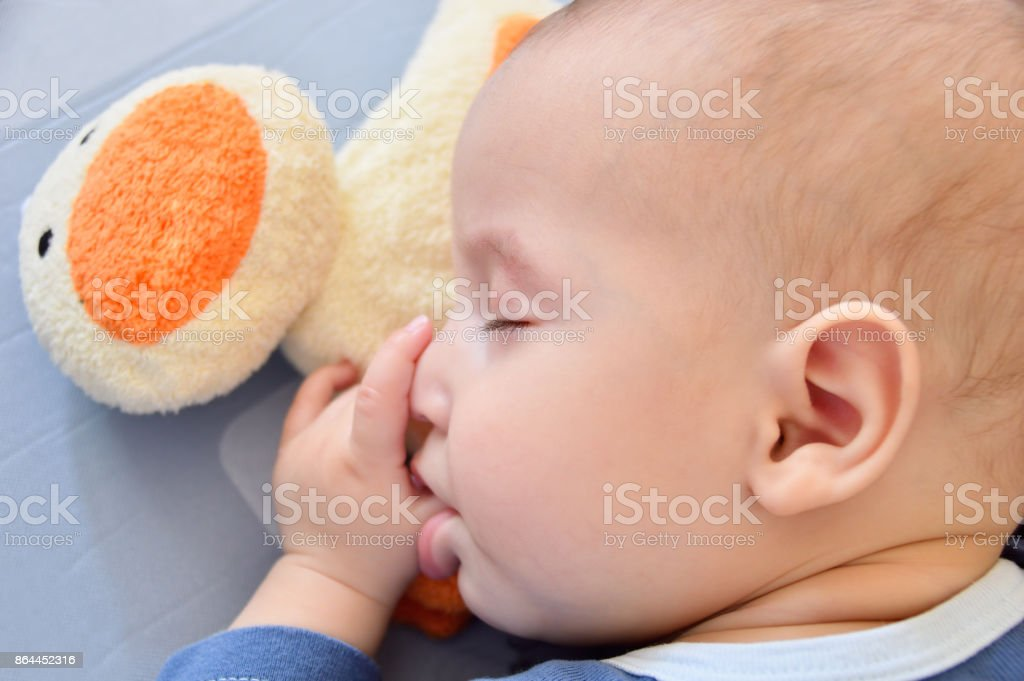 He always naps after feeding stock photo