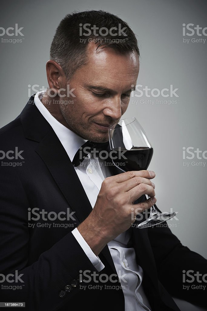 He appreciates a good wine stock photo