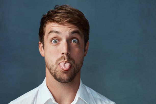 he can be a little cheeky at times - tongue stock pictures, royalty-free photos & images