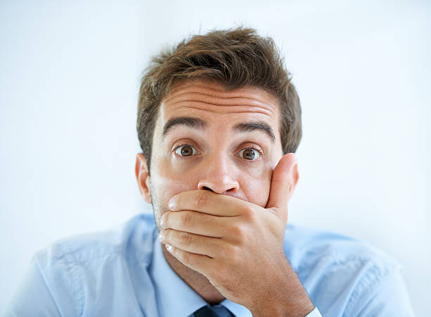 He cant believe his eyes Portrait of a young businessman covering his mouth with his hand finger on lips stock pictures, royalty-free photos & images
