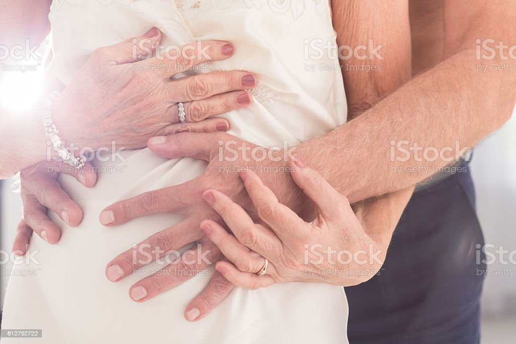 He can't keep his hands off stock photo
