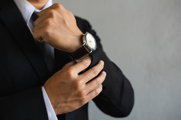 he checking time on watch closeup watch on hand businessman, he checking time on watch,Businessman wearing suit with a smart modern watch is thinking on white background,copy space. luxury watch stock pictures, royalty-free photos & images