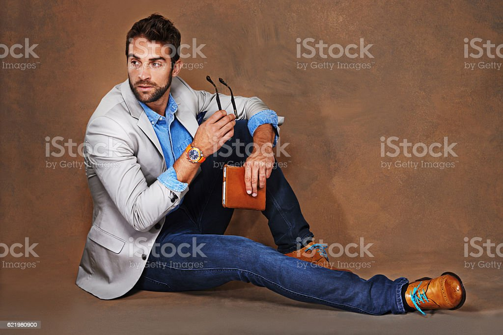 He clearly loves clothes and knows what suits him stock photo