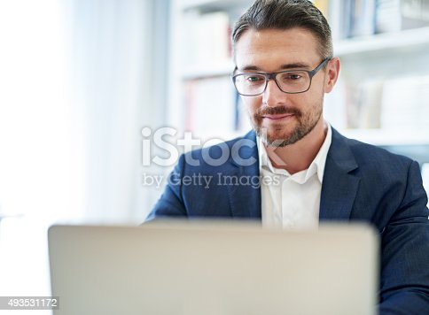 istock He does all his work online 493531172