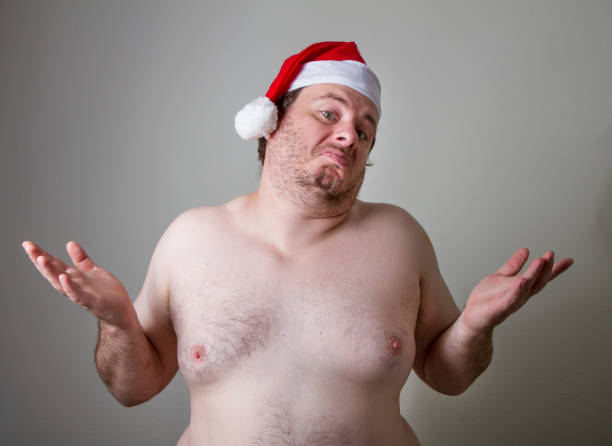 he doesn't care - naked santa claus stock pictures, royalty-free photos & images