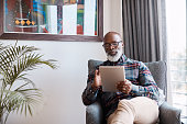 Shot of a mature man using a digital tablet at home