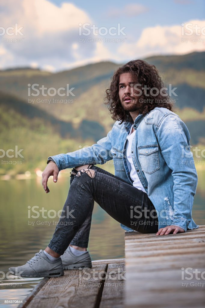 He enjoys the silence at the lake stock photo