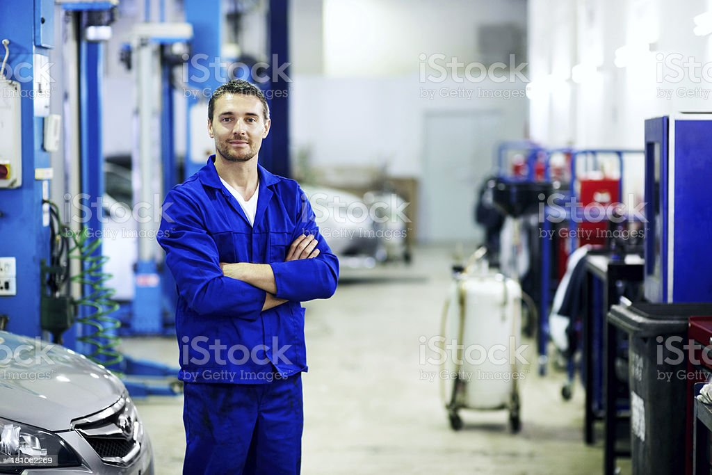 He enjoys working in the automotive sector stock photo