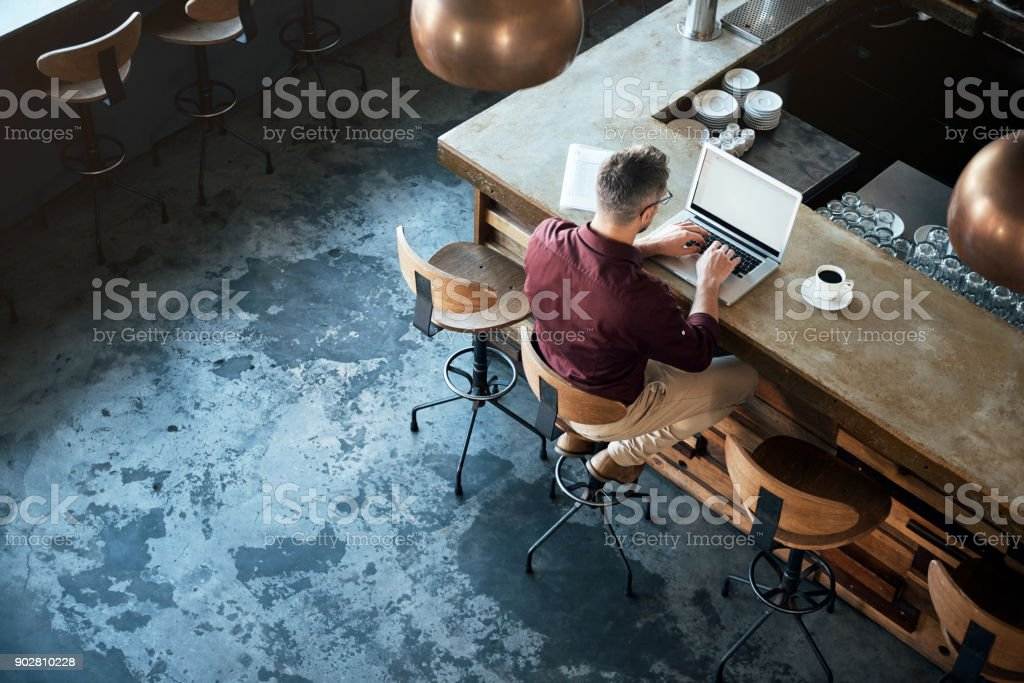 He enjoys working remotely stock photo