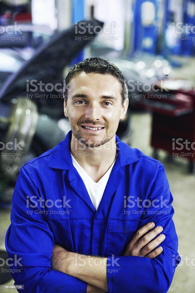He guarantees a thorough vehicle service! stock photo