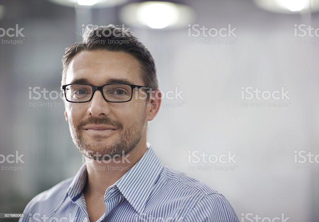 He has a clear vision for the company A cropped portrait of a handsome businessman standing in an office 30-39 Years Stock Photo
