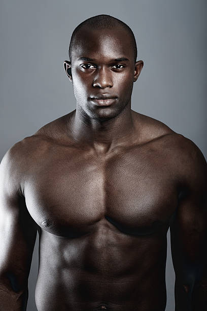 He has the perfect body A handsome and muscular young man posing in the studio shirtless male models stock pictures, royalty-free photos & images