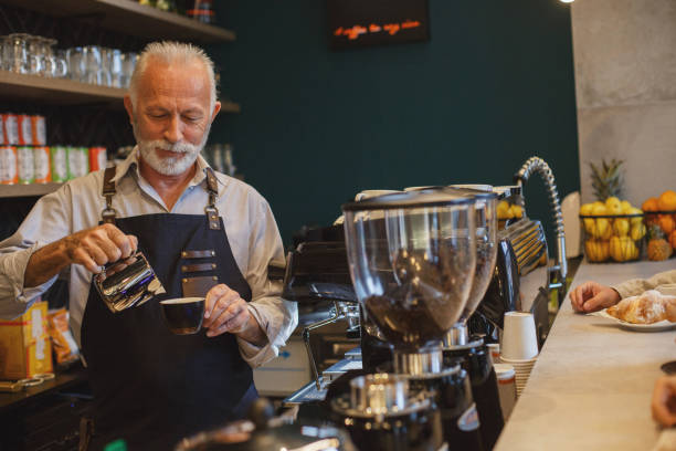 he has years of experience - barista making coffee stock photos and pictures