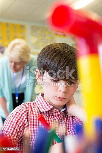 istock He is concentrating on his classwork 534038634