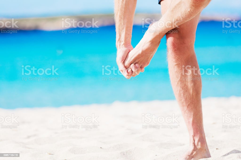 He is having pain in his toe maybe having gout stock photo