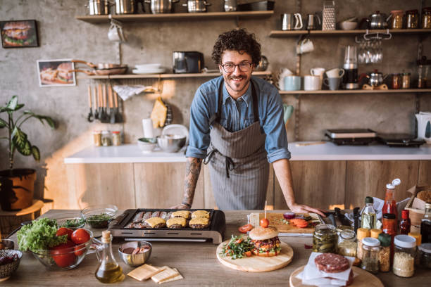 He is in his element when cooking stock photo