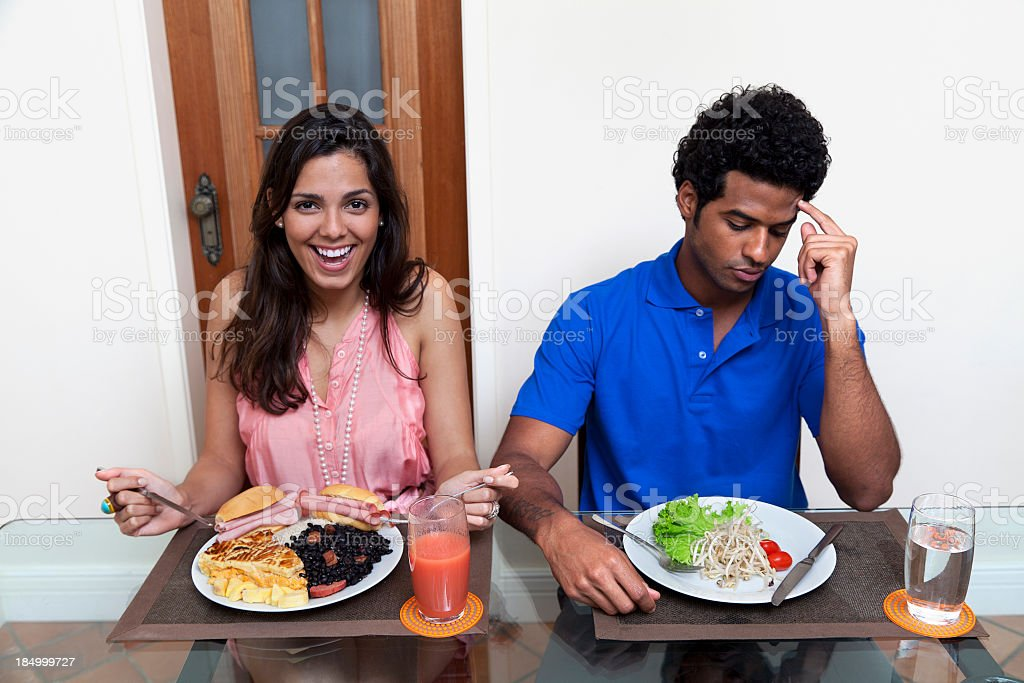 He is on a diet but she can eat everything royalty-free stock photo