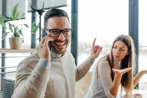 He is so rude. Frustrated angry woman waiting for him to finish phone call. inconvenience stock pictures, royalty-free photos & images