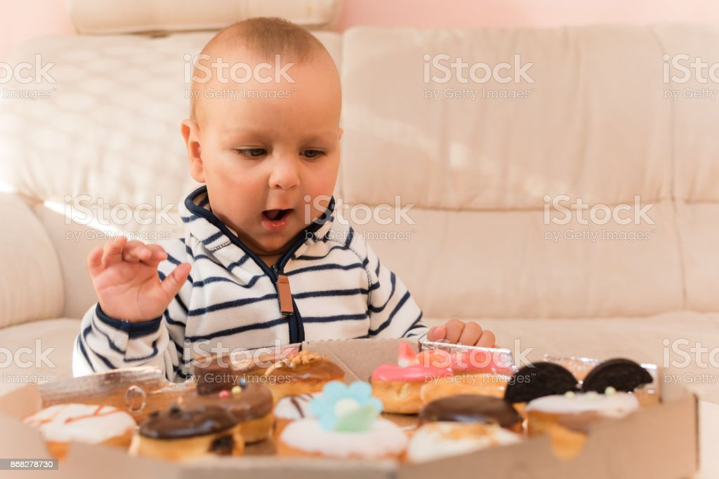 He is suprised with donuts stock photo