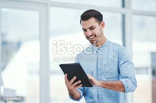 Shot of a young designer using a digital tablet in an office
