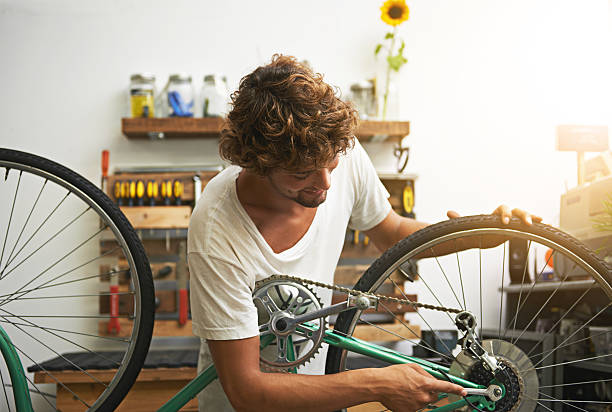 He knows his way around a bicycle stock photo