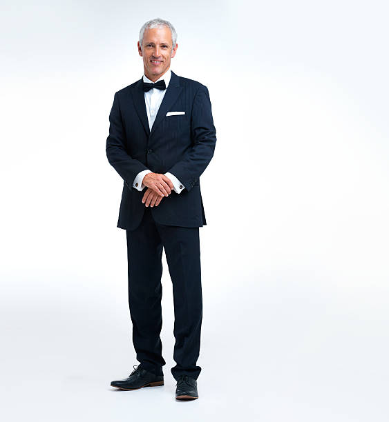He knows how to dress up A man wearing a suit and bow tie evening wear stock pictures, royalty-free photos & images