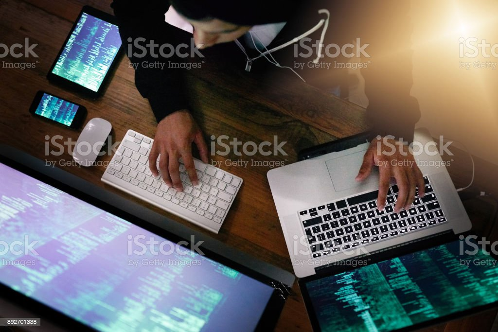He knows how to exploit weaknesses in every cyber system stock photo