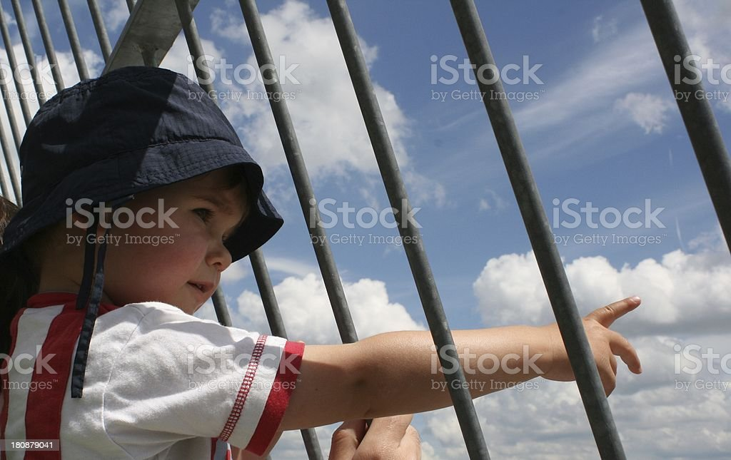 he looks through the fence stock photo