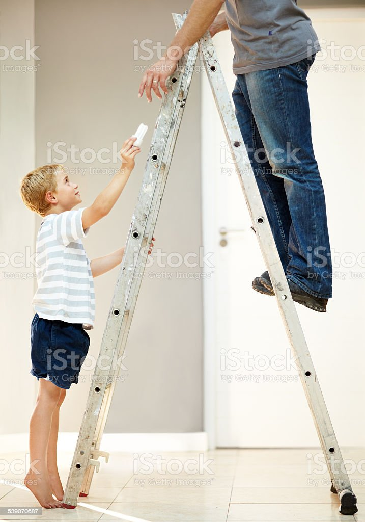 He loves assisting dad stock photo