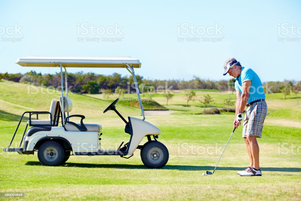He loves golfing! stock photo