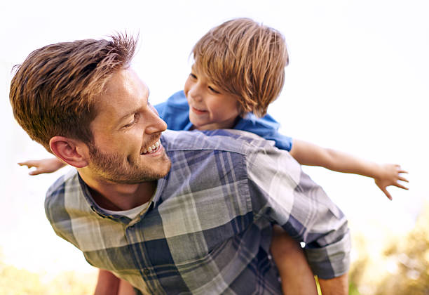 He loves his little boy so much Cropped shot of a young father giving his son a piggyback ridehttp://195.154.178.81/DATA/i_collage/pi/shoots/783329.jpg piggyback stock pictures, royalty-free photos & images