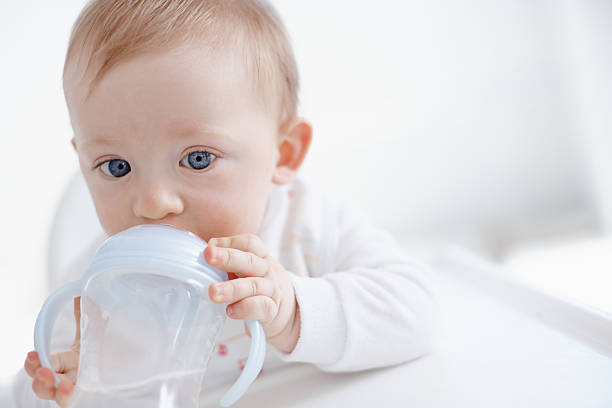 He loves that sippy cup! stock photo