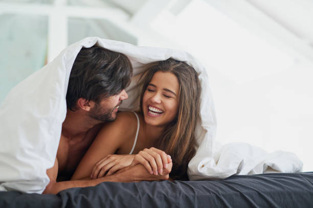 He loves the sound of her laughter stock photo