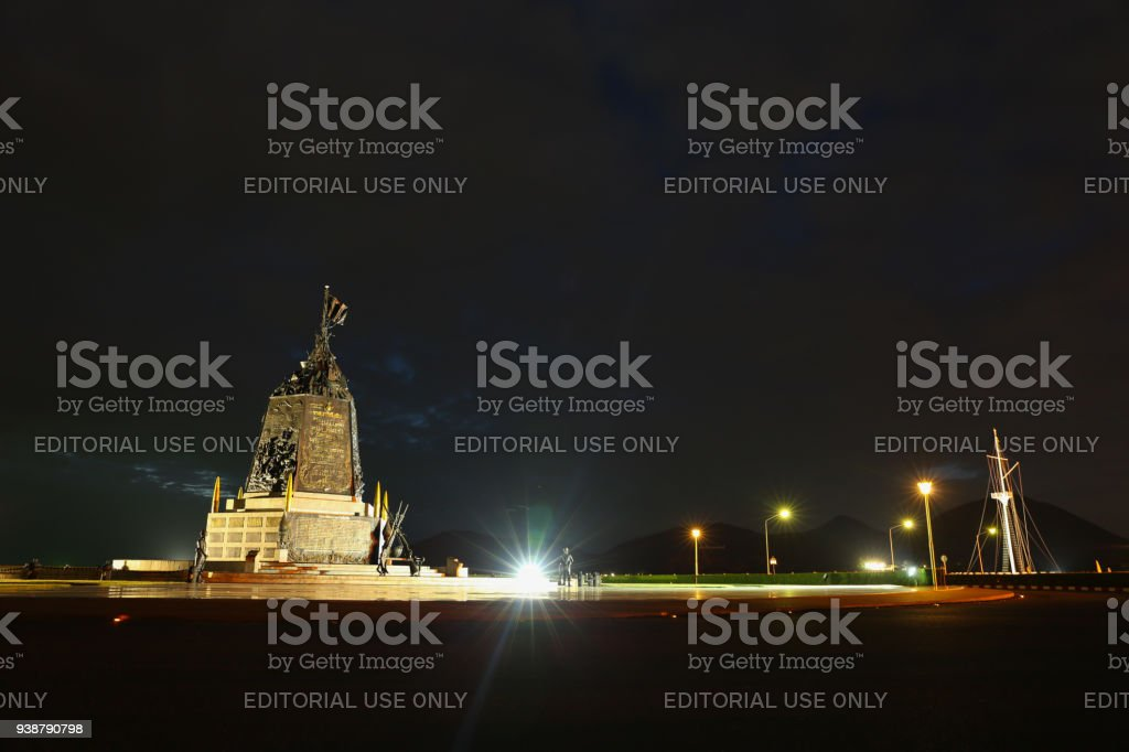 he Marine Corps Monument along the sea in night time in Sattahip Chonburi  , Thailand. stock photo